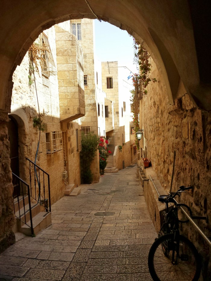 An alley seen through an arch in the Old City of Jerusalem