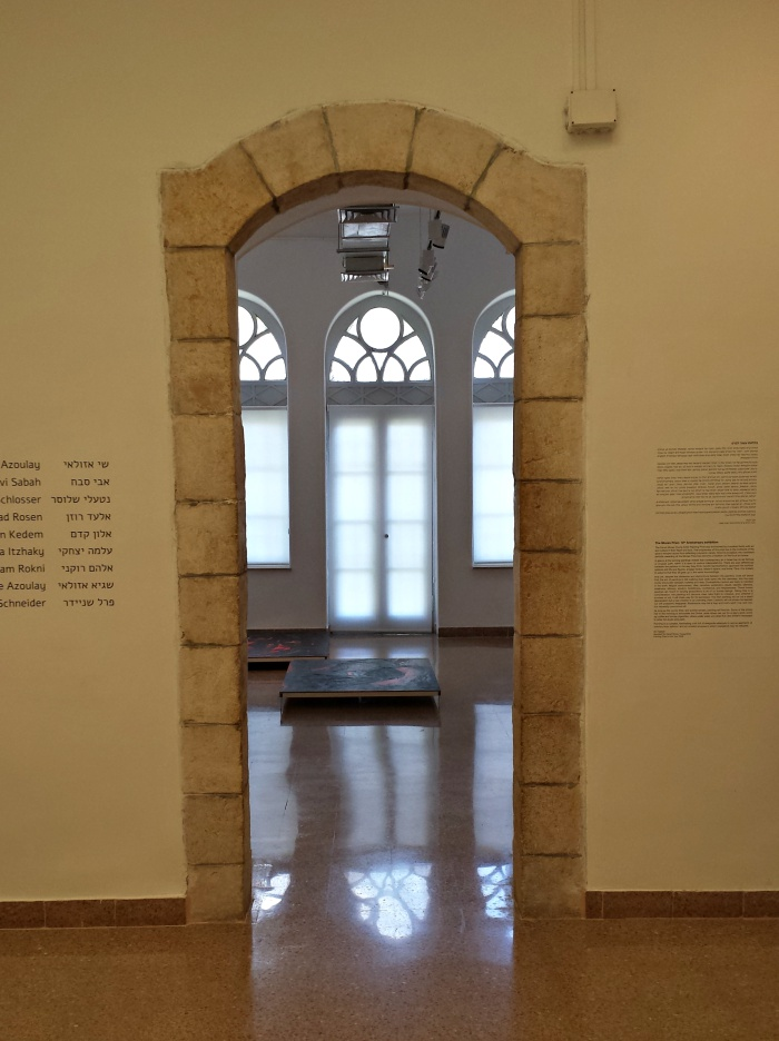 Arched doorway and windows with diffused light in Jerusalem Artists House