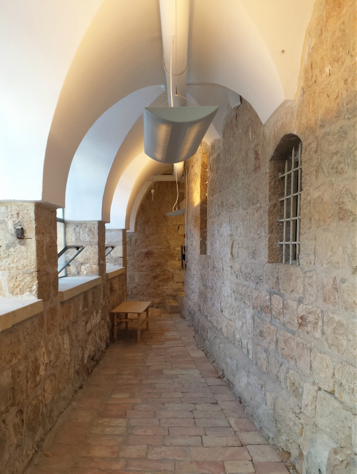 Corridor with arches in Hansen House, Jerusalem