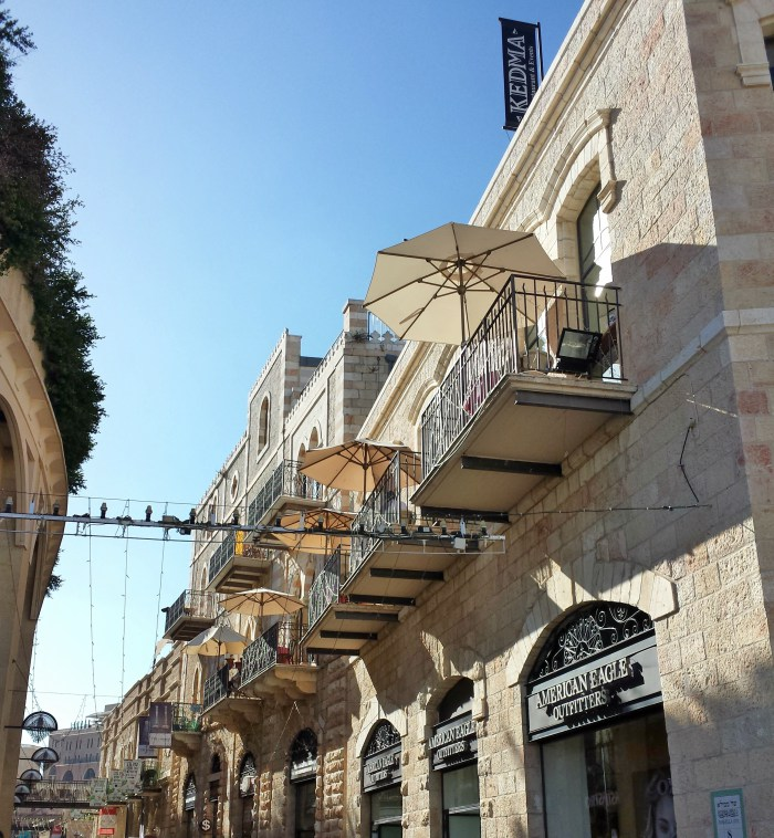 The pedestrian shopping avenue of Mamilla and it's buildings covered in Jerusalem Stone