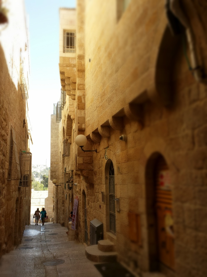 A narrow alley in the Old City of Jerusalem leading down to the Western Wall