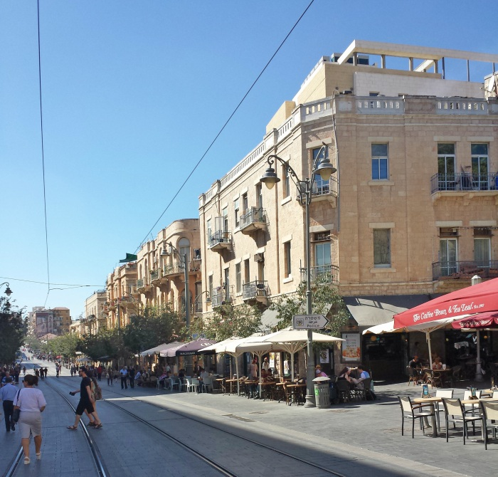 Pavement cafes and trees line Jaffa Street in Jerusalem