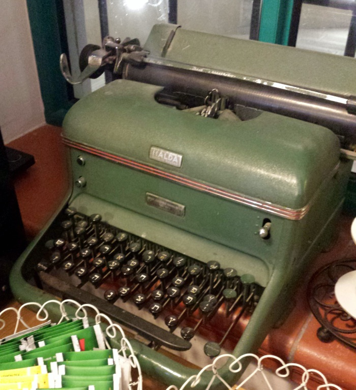 A vintage typewriter displayed as a decor accessory in a cafe