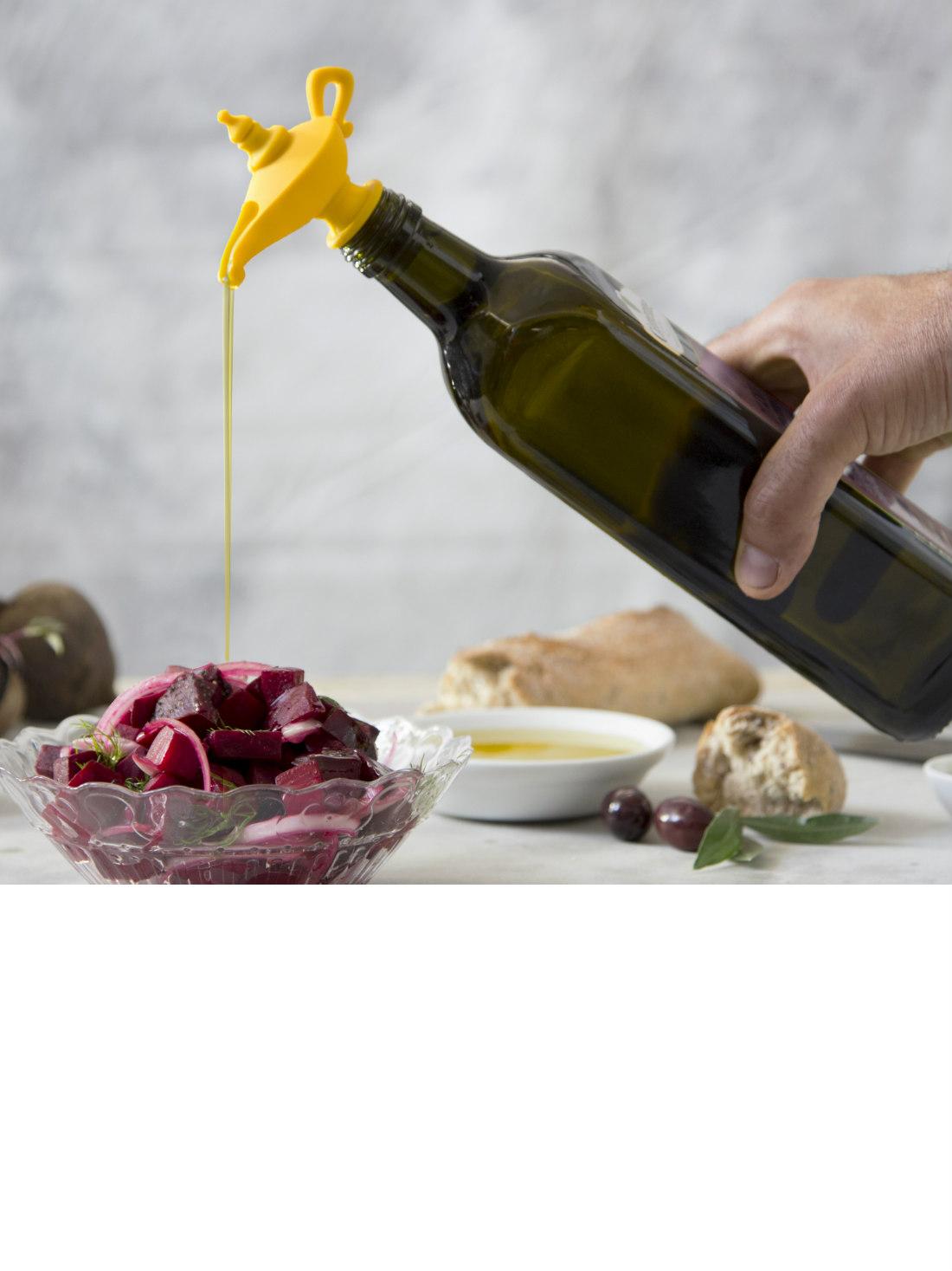 Oiladdin Oil Pourer and Bottle Stopper from brightblueliving.com